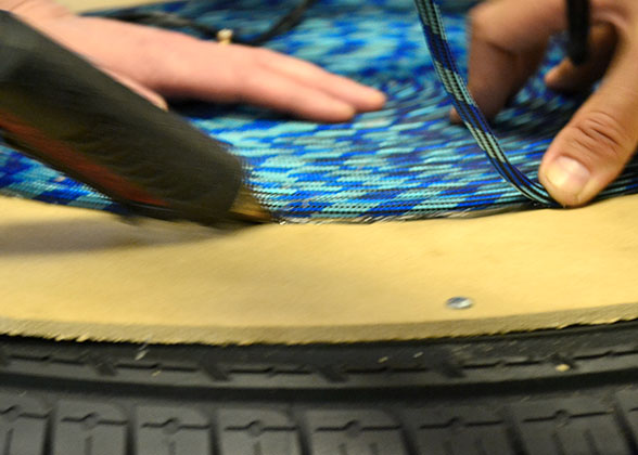 Glue and blue-green rope on tire ottoman