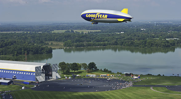 Goodyear blimp above field
