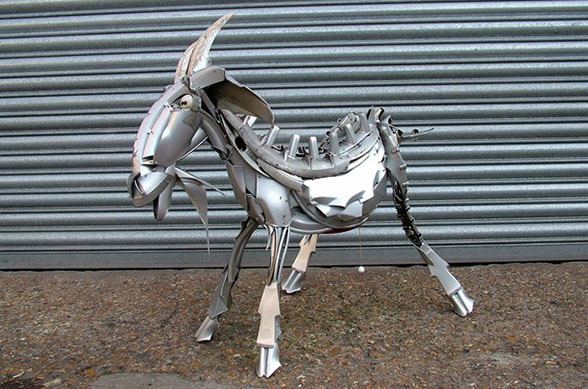 goat made from hubcaps