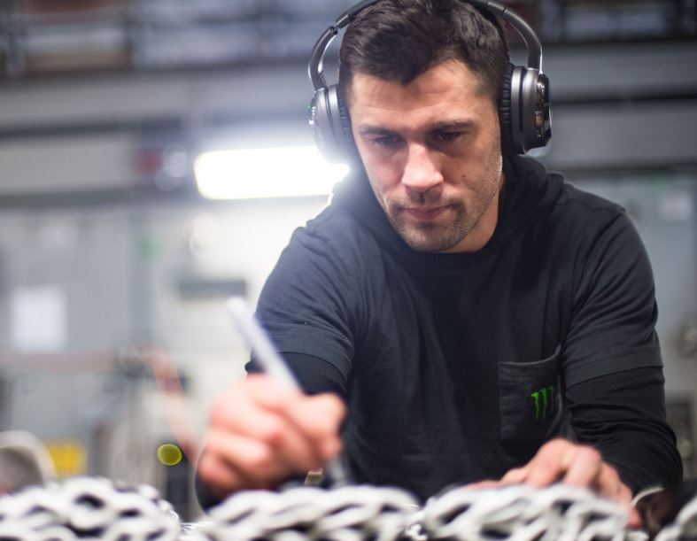 Mixed-martial artist Dominick Cruz signs MMA gloves